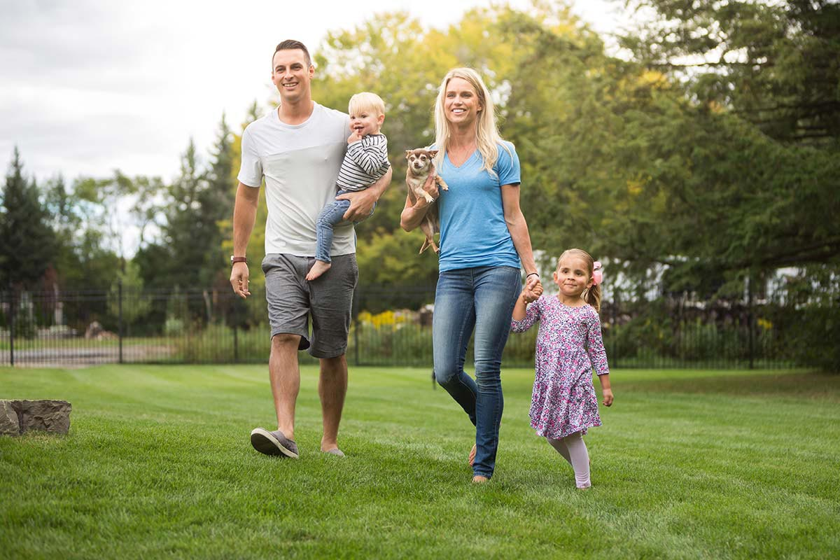 family walking on healthy lawn