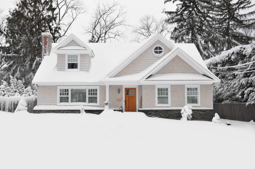 Snow Covered Cape Cod Style Home